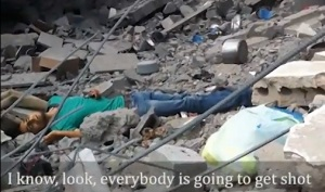 A YouTube screen cap of a man shot by an Israeli sniper while hunting through rubble for his family.