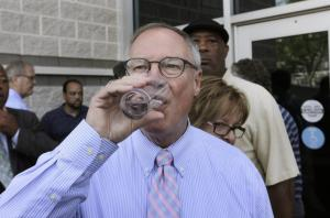 Toledo Mayor D. Michael Collins proudly takes a swig of fresh, wholesome Toledo water.