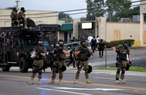 Ferguson's paramilitary police force patrols the streets. If something dramatic isn't done soon, much of Main Street, USA may one day look like this. Via Business Insider.