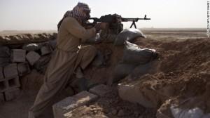 A Kurdish Peshmerga fighter holds a position Thursday, September 11, in Yangije, Iraq against ISIL. Photo from CNN.