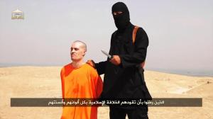 Captured journalist James Foley is about to be beheaded by an ISIL member in a widely disseminated video.