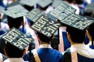 Graduates adorn their caps with the amount of the debt they get to start their adult life with.