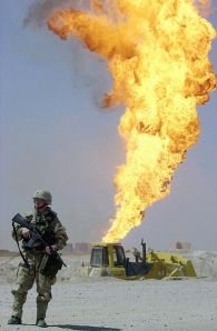A US soldier stands guard at the Rumaylah Oil Fields in southern Iraq.