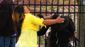 Toya Graham grabs her protesting son and forces him to go home with her.