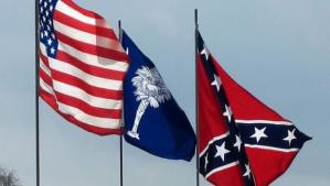 The U.S. flag, the South Carolina state flag, and the Confederate Flag all fly over the South Carolina's capitol building.