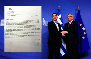 Greek Prime Minister Alexis Tsipras, left, meets with European Central Bank President Mario Draghi.