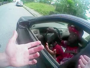Samuel DuBose argues with Officer Ray Tensing, whose hands are seen here on his body cam. Moments later, Tensing shot DuBose as he began accelerating.