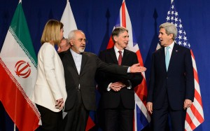 Iranian Foreign Minister Mohammad Javad Zarif, second-left, stands on stage with diplomats in Switzerland, including US Secretary of State John Kerry, far right.