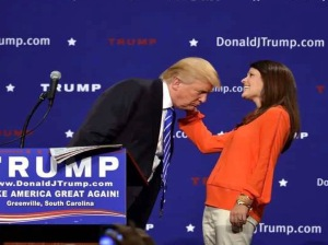 A woman pulls Donald Trump's hair at an event to prove it's real. This passes for
