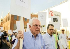 Presidential candidate Bernie Sanders pickets with Iowa workers last week. As a senator, Sanders also recently introduced legislation that would guarantee paid vacation time to full-time workers.