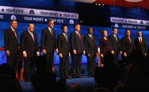 GOP candidates line up at their most recent debate with the oddly appropriate tagline,