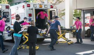 An all too familiar American scene: victims of a mass shooting taken to a hospital in Roseburg, OR.