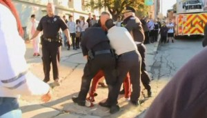 Police in Rhode Island pepper spray and arrest a group of students and teachers protesting police brutality.