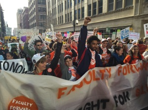 Students, faculty and low-wage workers march in solidarity in downtown Chicago.